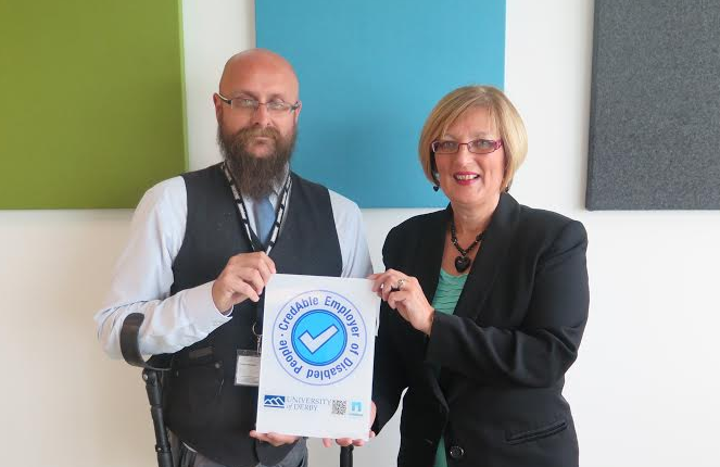 Nimbus MD Martin presents Lesley, Head of E&D at the University, with the CredAble Employer Quality Mark