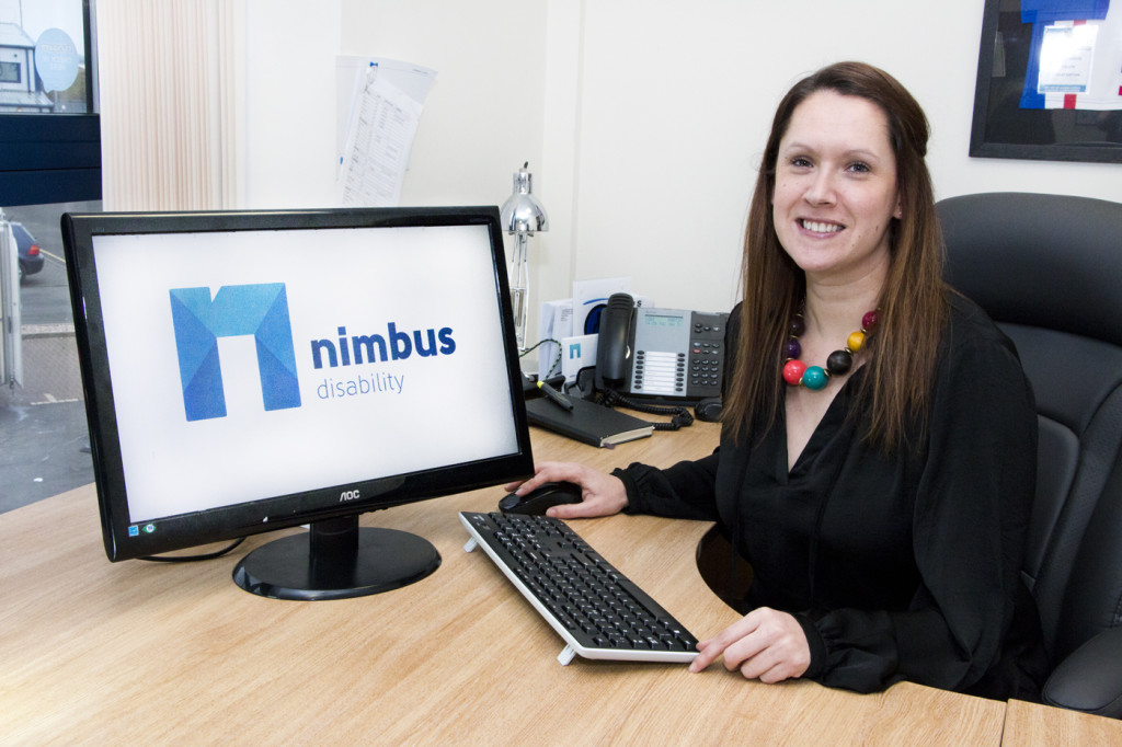 image of sally sitting at a desk with the nimbus logo displayed onscreen